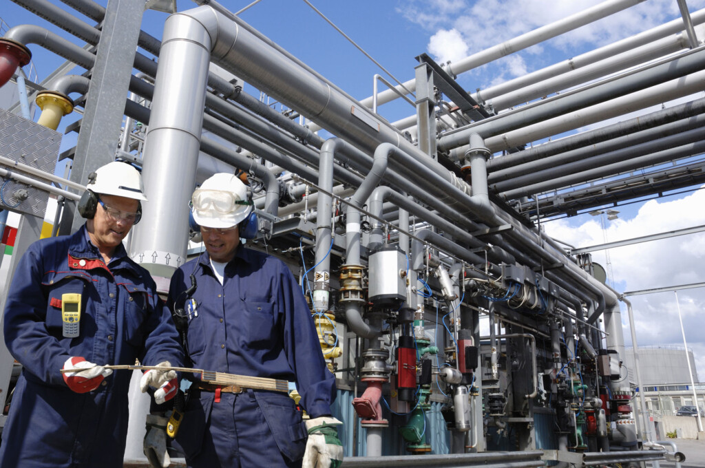 Two engineers standing in front of chemical plant